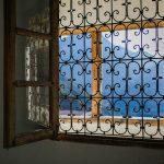 ornamental bars on window in sunlight
