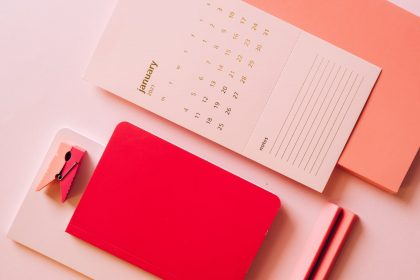 composition of notepads and calendar of new month